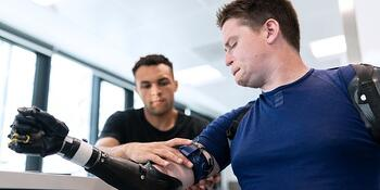bionic arm being fitted by a healthcare prototype manufacturer
