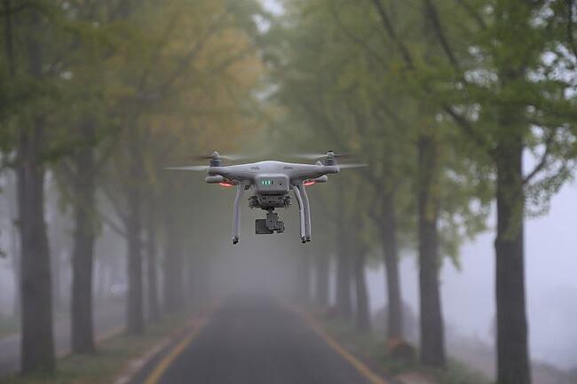 Drone flying on road
