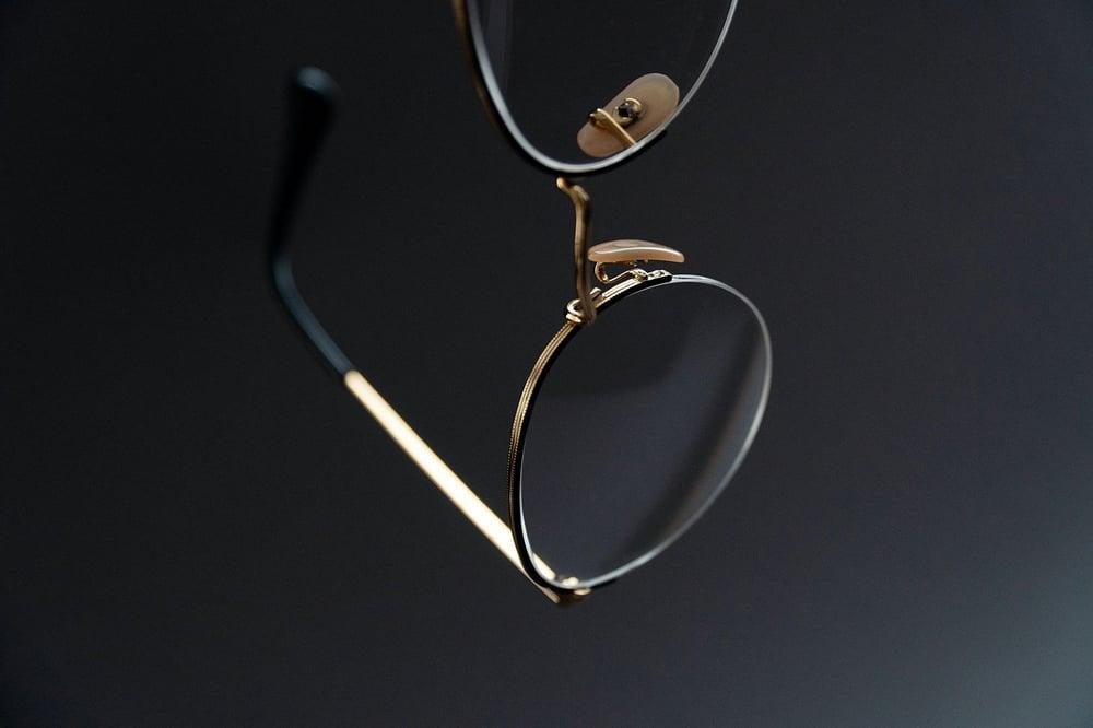 eyeglasses on black background_bartosz-sujkowski-oFF-5I-yXCM-unsplash