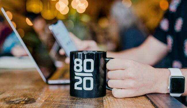 startup image of a busiess founder drinking from a 80 slash 20 coffee mug